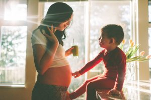 Pregnant mom and child drinking smoothie